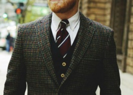 What is tweed jacket worn with?